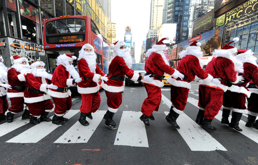 Santa Clauses are hopping through town! PEEPS® Santas channel their inner Easter Bunny and spread holiday cheer in NYC.