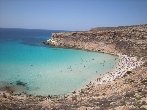 The top beach in the world is Rabbit Beach in Lampedusa, Italy, according to the 2013 TripAdvisor Travelers' Choice Beaches Awards.