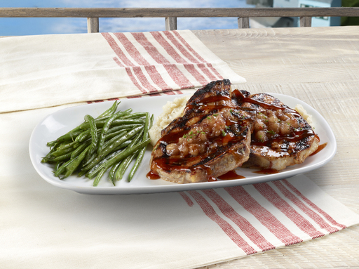 Wood-Grilled Pork Chops topped with apple compote and peach-bourbon BBQ sauce
