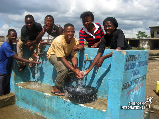 Providing access to clean water brings smiles to the youth who worked to help others.