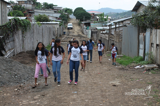 Members of the youth leadership group walking the streets of La Ladrillera, where the donated clothing was distributed.