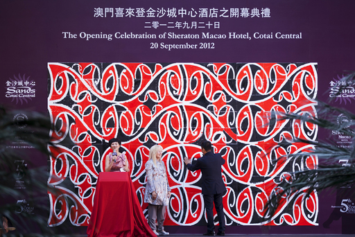 Sands and Starwood representatives complete a Polynesian kowhaiwhai mural at Sands Cotai Central Thursday, at a community event at the integrated resort's second phase opening.