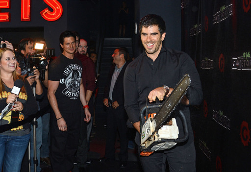 With chainsaw in hand, Eli Roth revs up the GORETORIUM black carpet as he welcomes guests and onlookers to the opening of one of the most terrifying haunts in the country.