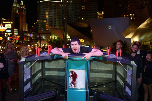 In the middle of GORETORIUM's outdoor lounge, Eli Roth tries to escape a torturous 'exercise machine' as guests witness the bloody atrocity coming out of the actor's stomach.