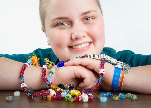The St. Jude Legacy Bead Program gives patients a tangible way to illustrate their journeys. Fifty-five beads have been assigned to experiences often faced by children with life-threatening diseases.