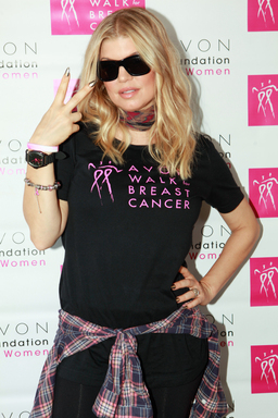 Avon Foundation Global Ambassador Fergie sports the 20th Anniversary Avon Breast Cancer Crusade Watch, available for $20 with 100% of net proceeds benefitting the Avon Breast Cancer Crusade.