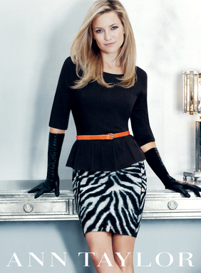 Kate Hudson strikes a pose wearing the Fete Peplum Sweater, Zebra Stripe Straight Skirt, Watersnake Skinny Belt and Posh Leather Gloves during the Ann Taylor Holiday 2012 campaign shoot in NYC