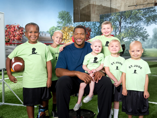 Michael Strahan next to St. Jude Children's Research Hospital Patients
