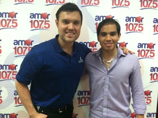 On Air Talent at Univision Radio, Alberto Sardiñas next to St. Jude patient Luis Enrique