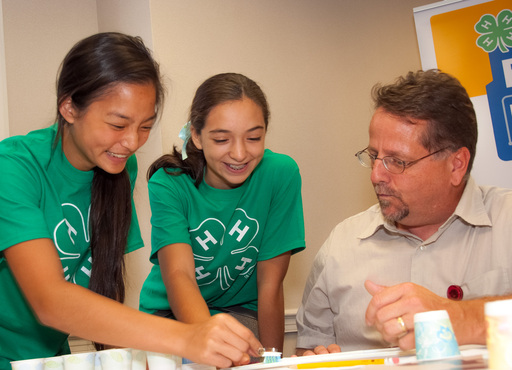 4-H young people work with their adult mentor to test their Eco-Bot prototype.