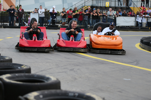 Quicken Loans surprised race fans with a chance to go head-to-head against NASCAR drivers Tony Stewart (left) and Ryan Newman at NASCAR SpeedPark in Concord, N.C., on Wednesday, Oct. 10.