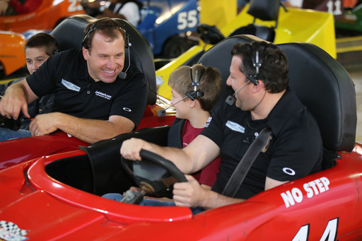 Quicken Loans surprises race fans with go-kart appearance by Ryan Newman and Tony Stewart