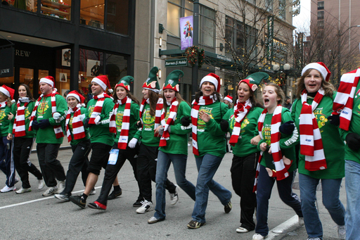 Jingle Bell Run team links arms and walks through the 5k event to show support in their local community
