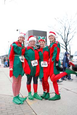 Santa's helpers pose for a quick photo before heading to the start line