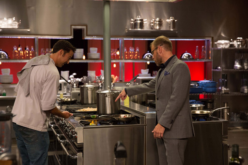 Alton Brown and a competitor on Food Network's Cutthroat Kitchen