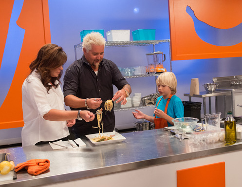 Rachael Ray, Guy Fieri with a kid competitor on Rachael vs Guy Kids Cook-Off