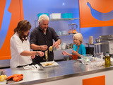 58440-rachael-ray-guy-fieri-with-a-kid-competitor-on-rachael-vs-guy-kids-cook-off-sm