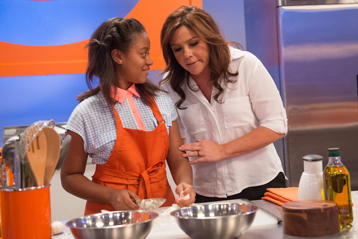 Rachael Ray and one of her team members on Rachael vs Guy Kids Cook-Off