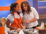 58440-rachael-ray-and-one-of-her-team-members-on-rachael-vs-guy-kids-cook-off-sm