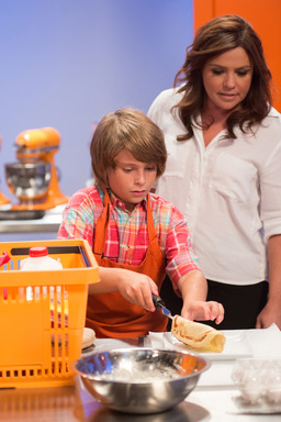 Rachael Ray with Kid Competitor on Rachael vs Guy Kids Cook-Off