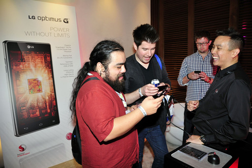 "Edgar Cervantes (left) and Chris Chavez (right) from Phandroid.com take LG Optimus G's quad-core processor for a spin at LG's ""Live Without Boundaries"" event in San Diego"