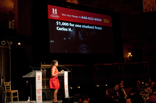 Host Carmen Wong Ulrich leads the HSF text to pledge campaign which raised $125K.