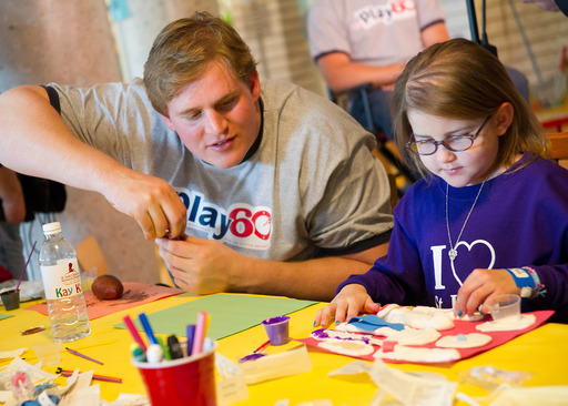 Barrett Jones with St. Jude patinet Darcy doing crafts