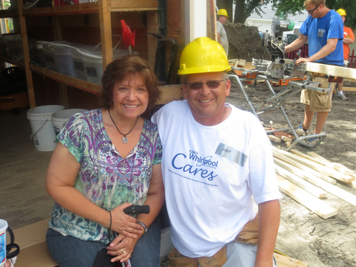 Future homewner, Carol Scheidt, takes a break from building with Whirlpool Corporation Volunteer Jeff Anderson