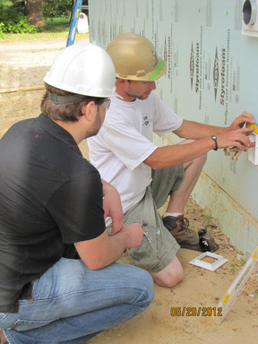 Volunteers installing plumbing during the Whirlpool Corp-sponsored Habitat for Hunamity build in Harbor Shores.