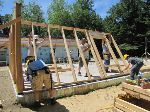Volunteers putting up a wall during the Whirlpool Corp-sponsored Habitat for Humanity build in Harbor Shores.