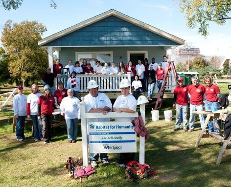 Whirlpool Corporation, Habitat for Humanity and IU volunteers show off their handiwork in front ot the nearly completed Kell Family home.