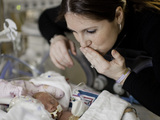 58942sp-mom-kissing-nicu-baby-sm