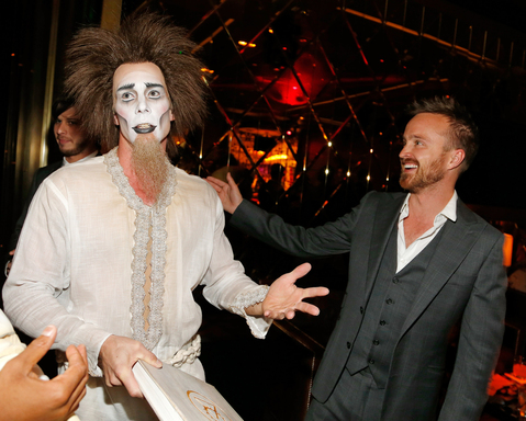 "Actor Aaron Paul (R) with ""Zarkana by Cirque du Soleil"" character at the Las Vegas premiere of ""Zarkana by Cirque du Soleil"" (Photo by Isaac Brekken/Getty Images for Cirque du Soleil)"