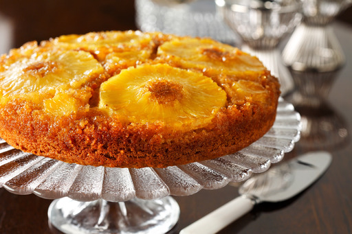Pineapple Upside Down Cake was made famous by women's magazines in the 1930s after canned pineapple became available in slices. Canola oil helps keep this recipe moist, light and low in saturated fat.
