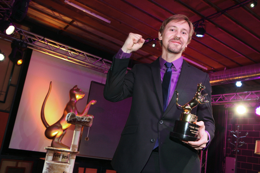 """Oskar's First Toys"" director Mick Szydlowski won the $15,000 Grand Prize for Best Video, along with a Friskies Catuette trophy and a one-year supply of Friskies cat food."