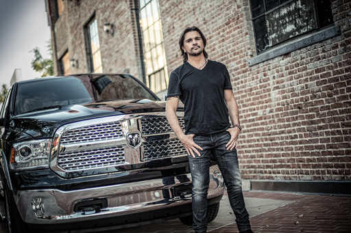 "Latin music superstar Juanes partners with the Ram Truck brand in the ""A Todo, Con Todo"" bilingual ad campaign for the 2013 Ram 1500 pickup.   Juanes is pictured here with the Ram 1500."