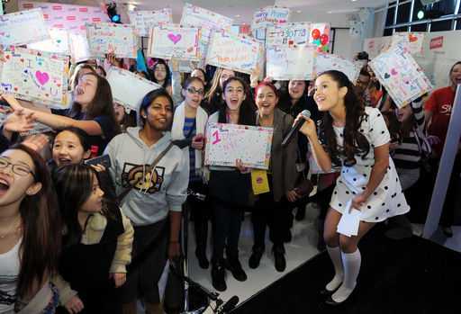 "Legions of screaming One Direction super fans, led by teen celebrity Ariana Grande, say ""hello"" to the boys prior to their upcoming tour. Fans can win a trip and tickets to an upcoming sold-out concert by entering at Facebook.com/Sharpie."