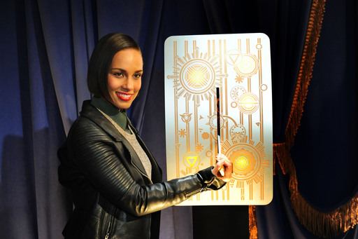"Alicia Keys ""flips the switch"" to unveil the Empire State Building's new LED tower lights with an exclusive light show choreographed to her songs, ""Girl on Fire"" and ""Empire State of Mind"" on Monday, November 26, 2012."