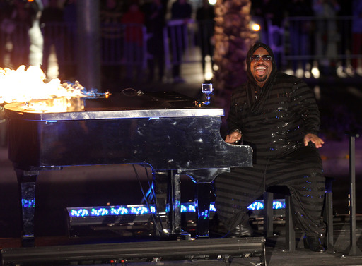 CeeLo Green plays a flaming piano down the Las Vegas Strip as he arrives at Planet Hollywood Resort & Casino on February 26, 2013 in Las Vegas, Nevada. (Photo by Isaac Brekken/WireImage)