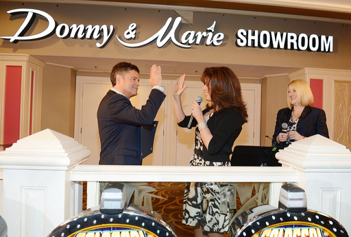 Donny and Marie Osmond celebrate the renaming of the Donny & Marie Showroom with Flamingo Las Vegas Regional President Eileen Moore
