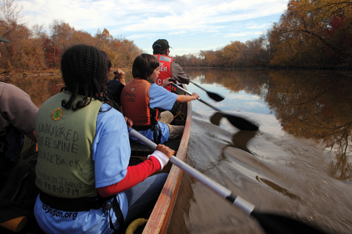 Learning to paddle a voyageur canoe on the Anacostia River- Photo by Keith Hyde, US Army Corps of Engineers, 2011; Wilderness Inquiry, Minneapolis, Minnesota.
