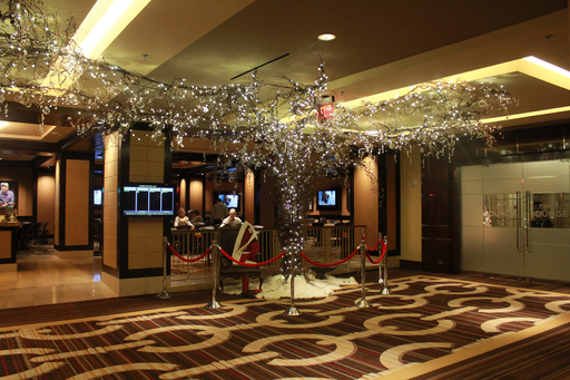 Horseshoe Cleveland's World Series of Poker Room is adorned with a custom built holiday tree at its entrance. The tree's branches spider 23 feet across the ceiling.