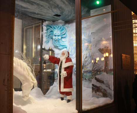 Heralding back to the beloved display cases of  Higbee's Department Store, Horseshoe Casino's  window on Cleveland's Public Square features Old Man Winter blowing winter snow down upon St. Nick.