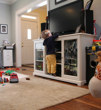 Kids might be tempted to reach items placed on or near a TV, such as remote controls.