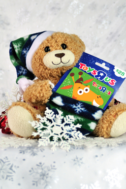 "Match the card with the perfect gift card holder. A teddy bear with a stocking to hold the card ($8.99 at Safeway) is perfect for a Toys ""R"" Us gift card."