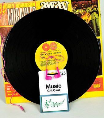 Go retro to give a music downloading gift card. Add a pair of neon ear buds ($14.99 at Safeway) for extra flare.