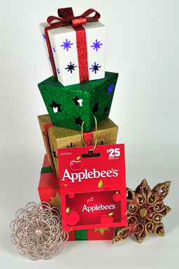 A gift card given with a holiday ornament will bring fond memories of your gift for years to come.