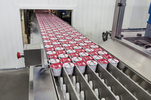 The first cups of yogurt ever produced at Chobani's new Twin Falls, Idaho manufacturing plant, roll down the line Tuesday, November 20, 2012. Chobani Bite, hits shelves nationwide in January 2013.