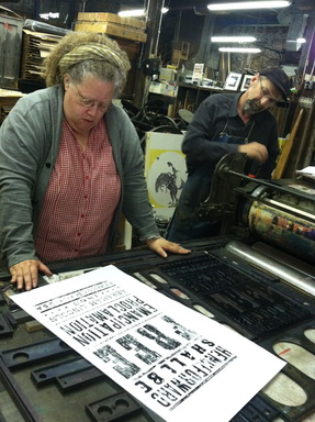 Emancipation Proclamation Stamp Designer, Gail Anderson, looks at the initial hand-pulled proof of the new stamp at Hatch Show Print in Nashville, TN.