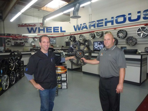 Chris Granger (left), owner of Wheel Warehouse and newest master distributor for Carbon Revolution's award-winning light-weight CR-9 ''one-piece'' carbon fiber wheel, joins Bill Koenig of Carbon Rev.